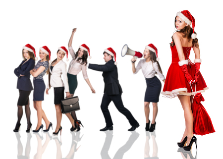 business costume: Beautiful and sexy woman wearing santa claus costume with her business team on the white background