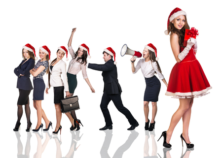 santa claus costume: Beautiful and sexy woman wearing santa claus costume with her business team Stock Photo