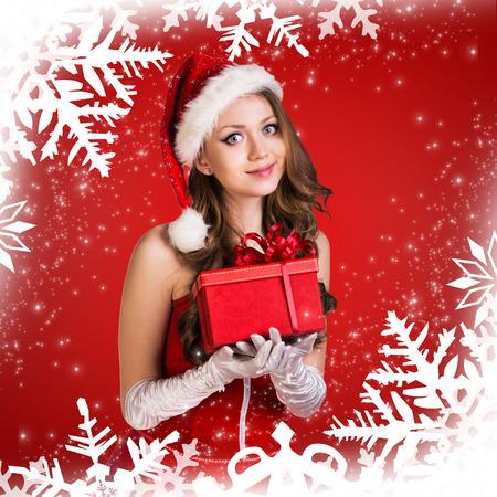 sexy santa girl: Sexy santa girl holds gift box on the snowflakes pattern Stock Photo