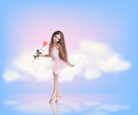 fluffy clouds: Cute little girl dancing in blue sky with clouds.