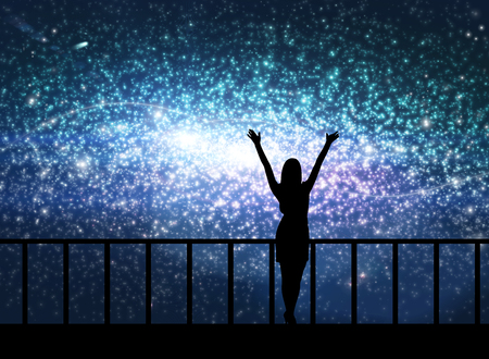 natural light: Silhouette of young happy woman stands on the bridge in cosmos