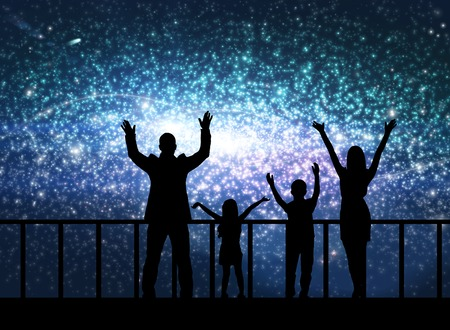 family constellation: Silhouette of happy family on the bridge in cosmos station