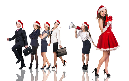 business costume: Beautiful and sexy woman wearing santa claus costume with her business team Stock Photo