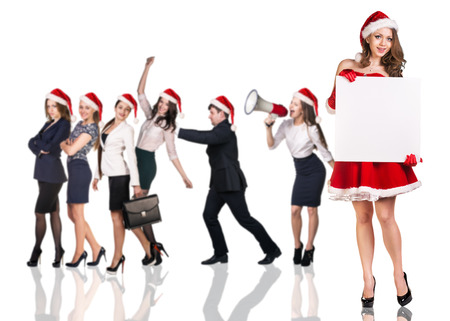 celebrate year: Beautiful and sexy woman wearing santa claus costume with her business team on the white background