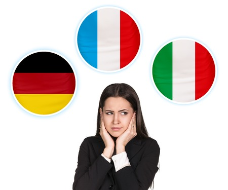 fluency: Young woman surrounded by dialogue bubbles with countries flags. Germany,  Italian, Czech. Learning of foreign languages concept.