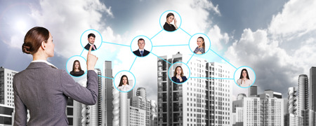 job opportunity: Businesswoman nearby portrait icons with connection lines. Urban background. Stock Photo