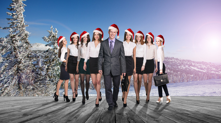 career man: Business people selebrating christmas corporate on the nature landscape
