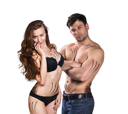 correction lines: Beautiful fitness young sporty couple with correction lines isolated over white background Stock Photo