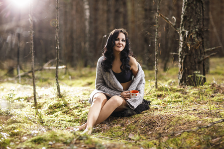 mysterious woman: Portrait of a beautiful mysterious woman in the forest Stock Photo