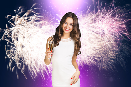 Young woman in white dress with champagne on the white background