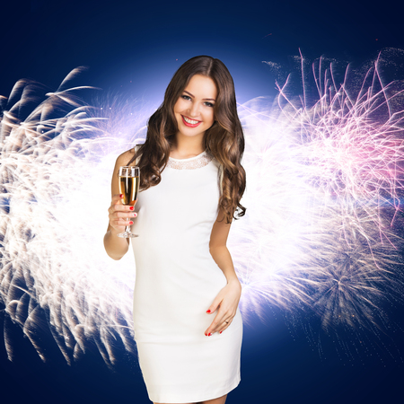 woman in dress: Young woman in white dress with champagne on the white background
