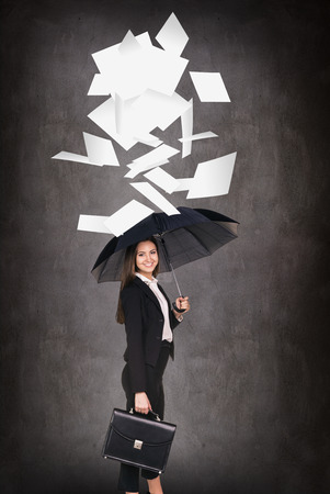 young worker: Young business woman throws up paper sheets. Vacation concept Stock Photo