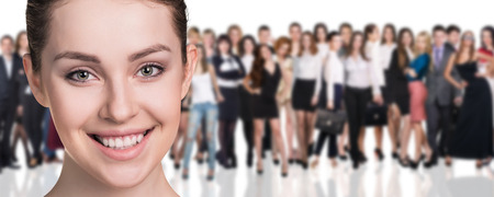 happy business team: Big crowd of business people and young woman foreground. Isolated over white background