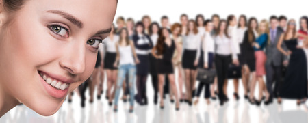 Big crowd of business people and young woman foreground. Isolated over white background