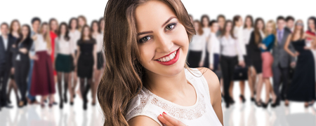 confident business woman: Big crowd of business people and young woman foreground. Isolated over white background