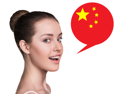 fluent: Beautiful woman speak.Bubble with Chinese flag. Isolated background.