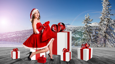 christmas tree presents: Beautiful and sexy woman wearing santa clause costume