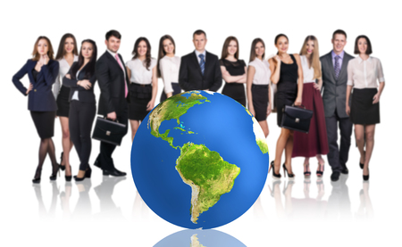 beside: Group of successful businesspeople beside big earth ball.