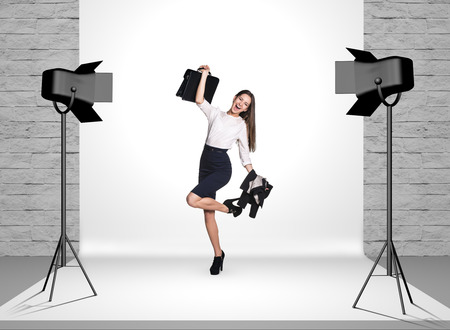 business cloth: Business woman in photo studio room with white cloth and spotlights Stock Photo