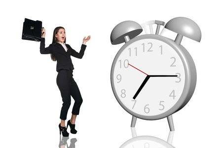 trotters: Business woman frightened big gray alarm clock isolated on the white