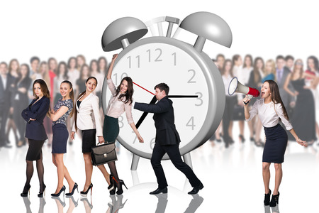 big behind: Business woman stands near big alarm clock, and crowd of people behind