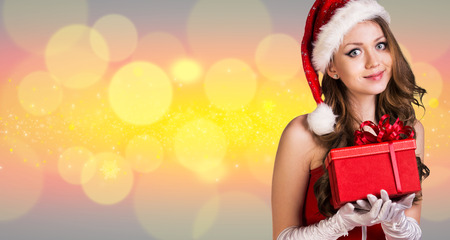 santa girl: Beautiful santa girl on the christmas background