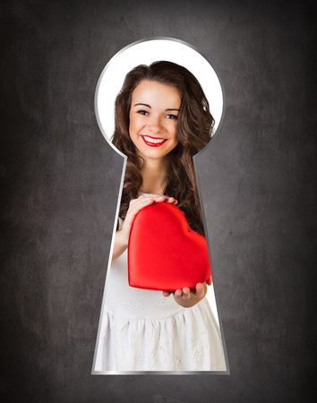 keek: Someone peeking through the keyhole of the happy girl Stock Photo