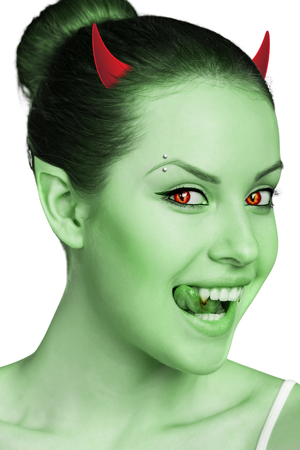 Beautiful woman with vampire fangs and horns isolated on white