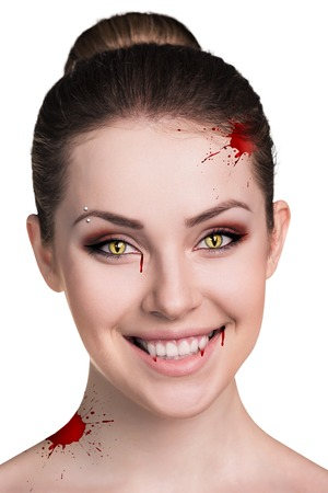 fangs: Beautiful woman with vampire fangs isolated on white