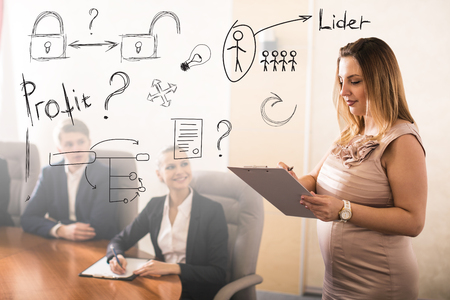 woman smiling: Young business people meeting in conference hall Stock Photo