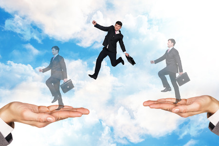 businessman jumping: Businessman jumping in the sky on hands Stock Photo