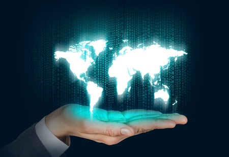 code: Human open hand with world map on the matrix background. Elements of this image furnished by NASA Stock Photo