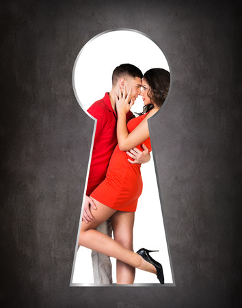 lock block: Someone peeking through the keyhole of the young couple