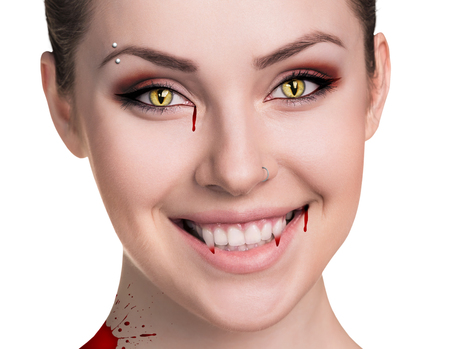 mouth smile: Beautiful woman with vampire fangs isolated on white