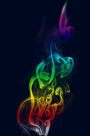 coloured background: Abstract colorful smoke isolated on the black background Stock Photo