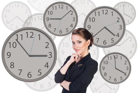 oversleep: Young business woman stands among big clocks Stock Photo