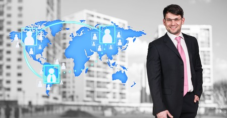 globe hand: Businessman stands near map with icons on the city background.