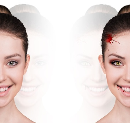 transparence: Beautiful woman with vampire fangs isolated on white