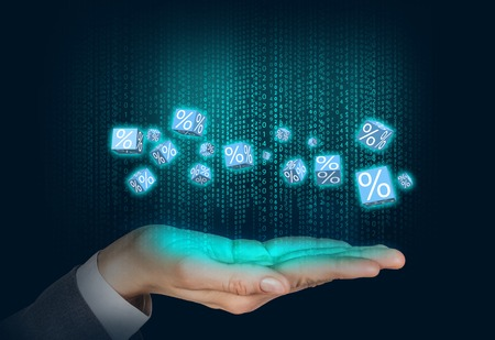aloft: Sales boxes floats on the human hand over matrix background Stock Photo