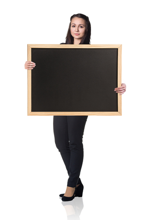 black secretary: Business woman holds empty chalkboard isolated on white Stock Photo