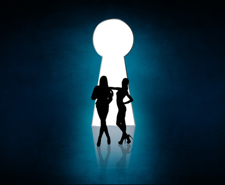 empty keyhole: Silhouette stands near big keyhole exit. Out concept. Blue background Stock Photo