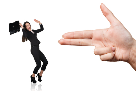 threaten: Human hand threaten with gun gesture young woman isolated on white