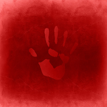 finger proof: Conceptual red painted hand imprint on the red wall background Stock Photo
