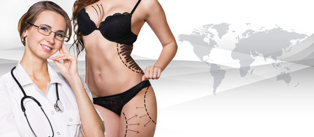 correction lines: Beautiful brunette woman in black underwear with correction lines on her body, Elements of this image furnished by NASA
