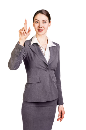 forefinger: Brunette businesswoman showing forefinger. Isolated on white. Stock Photo