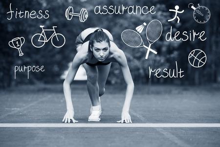 start line: Fitness female runner in ready start line pose outdoors in summer sprint challenge. Stock Photo