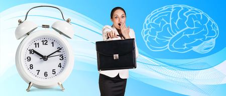 abstract alarm clock: Business woman near classical alarm clock on the blue abstract background Stock Photo