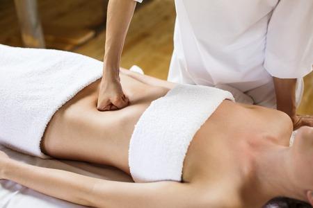 visceral: Beautiful young woman having visceral massage. Close-up Stock Photo