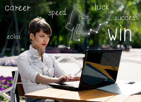 laptop outside: Young business woman with laptop working outdoors