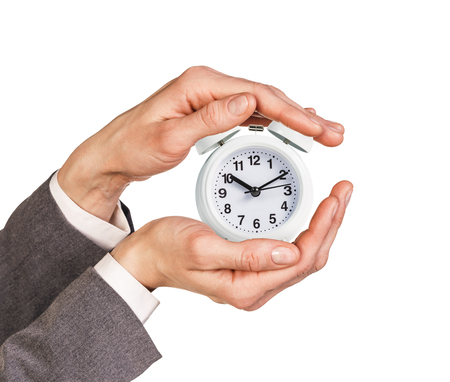 past midnight: Alarm clock stands on the human palm isolated on white background Stock Photo